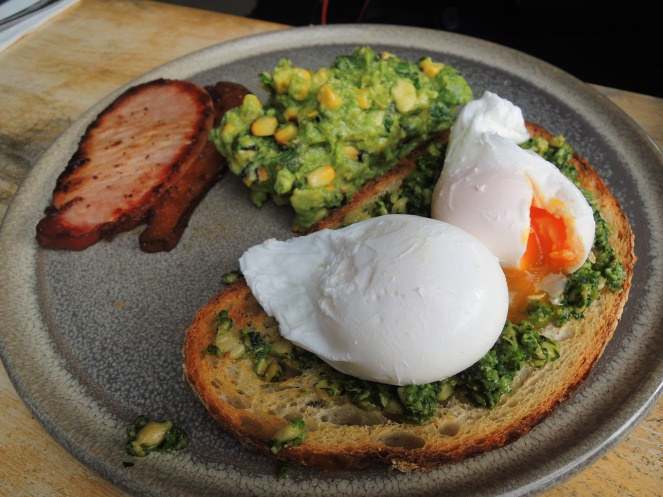 Bacon with an avocado and charred corn salsa on sourdough with eggs & pesto - $18